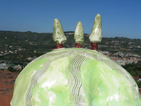 Immagine di una collinetta toscana con cipressi