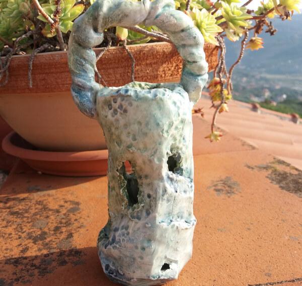 Immagine di un portafiori vaso a forma di casa